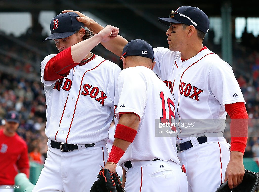 <a gi-track='captionPersonalityLinkClicked' href=/galleries/search?phrase=Clay+Buchholz&family=editorial&specificpeople=4424901 ng-click='$event.stopPropagation()'>Clay Buchholz</a> #11 of the Boston Red Sox is consoled by teammates <a gi-track='captionPersonalityLinkClicked' href=/galleries/search?phrase=Jacoby+Ellsbury&family=editorial&specificpeople=4172583 ng-click='$event.stopPropagation()'>Jacoby Ellsbury</a> #2 and <a gi-track='captionPersonalityLinkClicked' href=/galleries/search?phrase=Shane+Victorino&family=editorial&specificpeople=576251 ng-click='$event.stopPropagation()'>Shane Victorino</a> #18 of the Boston Red Sox after Buchholtz, lost a no hitter bid in the eighth inning, at Fenway Park on April 14, 2013 in Boston, Massachusetts. The Red Sox won the game 5-0.