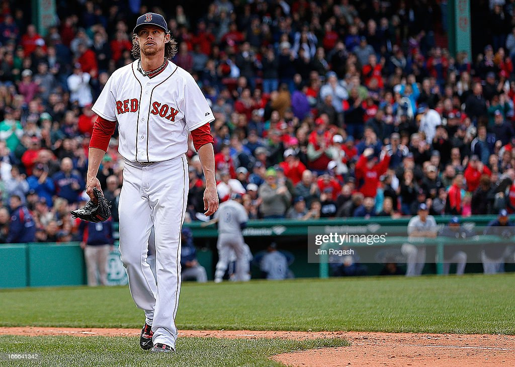 <a gi-track='captionPersonalityLinkClicked' href=/galleries/search?phrase=Clay+Buchholz&family=editorial&specificpeople=4424901 ng-click='$event.stopPropagation()'>Clay Buchholz</a> #11 of the Boston Red Sox leaves the field after pitching the eighth inning against the Tampa Bay Rays at Fenway Park on April 14, 2013 in Boston, Massachusetts. Buchholz took a no hitter into the eighth inning.