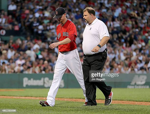Clay Buchholz of the Boston Red Sox leaves the game in the fourth inning against the New York Yankees at Fenway Park on July 10 2015 in Boston...