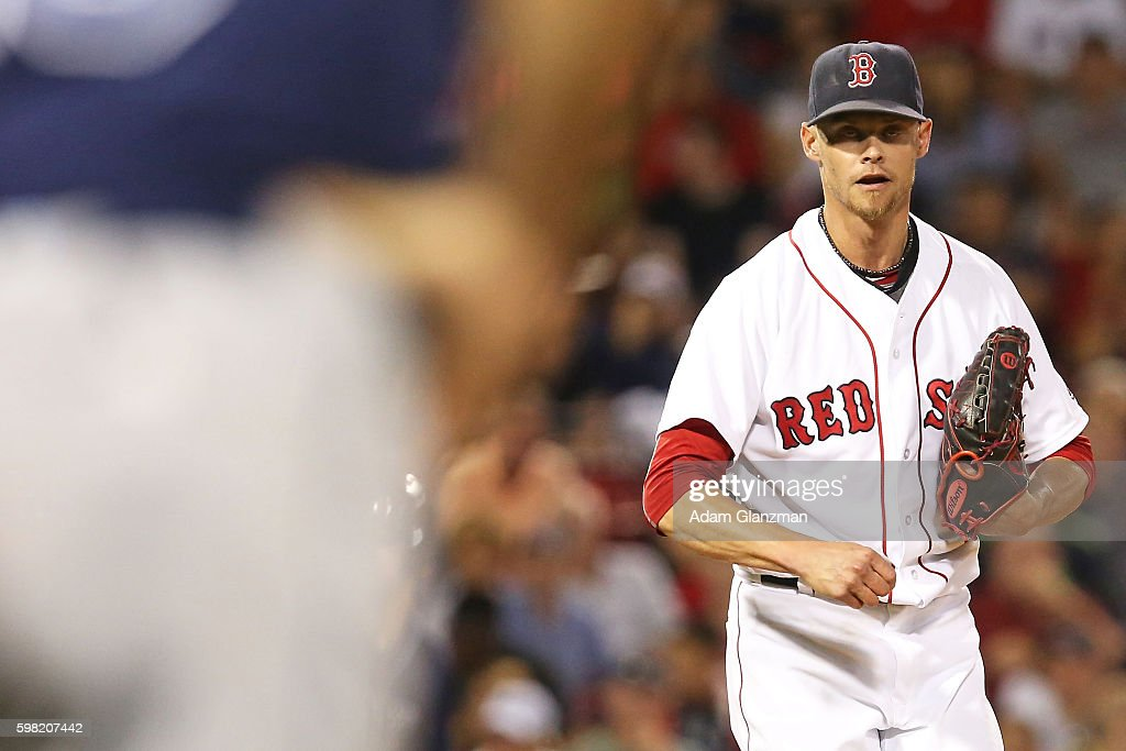 Clay Buchholz of the Boston Red Sox looks on in the eighth inning during a game against the Tampa Bay Rays at Fenway Park on August 29 2016 in Boston...