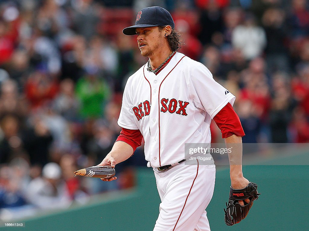 <a gi-track='captionPersonalityLinkClicked' href=/galleries/search?phrase=Clay+Buchholz&family=editorial&specificpeople=4424901 ng-click='$event.stopPropagation()'>Clay Buchholz</a> #11 of the Boston Red Sox picks up a broken bat used by Kelly Johnson #2 of the Tampa Bay Rays who spoiled a no hitter in the eighth inning with a broken bat single at Fenway Park on April 14, 2013 in Boston, Massachusetts.