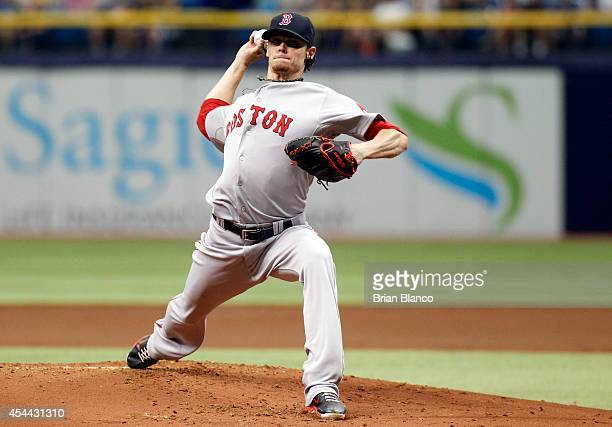 Clay Buchholz of the Boston Red Sox pitches during the first inning of a game against the Tampa Bay Rays on August 31 2014 at Tropicana Field in St...