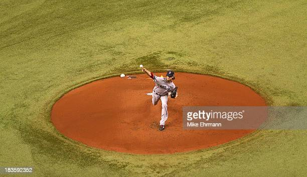 Clay Buchholz of the Boston Red Sox pitches in the first inning against the Tampa Bay Rays during Game Three of the American League Division Series...
