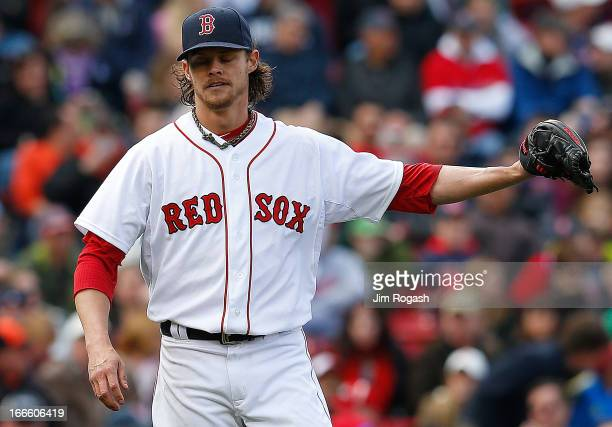 Clay Buchholz of the Boston Red Sox reacts after against the Tampa Bay Rays in the eighth inning after giving a second hit of the game at Fenway Park...