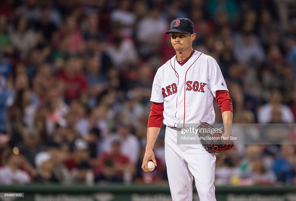 Clay Buchholz #11 of the Boston Red Sox reacts after allowing a two-run home run, the second two-run home run he allowed in the inning, to Dustin Garneau #13 of the Colorado Rockies in the fifth inning on May 26, 2016 at Fenway Park in Boston, Massachusetts.