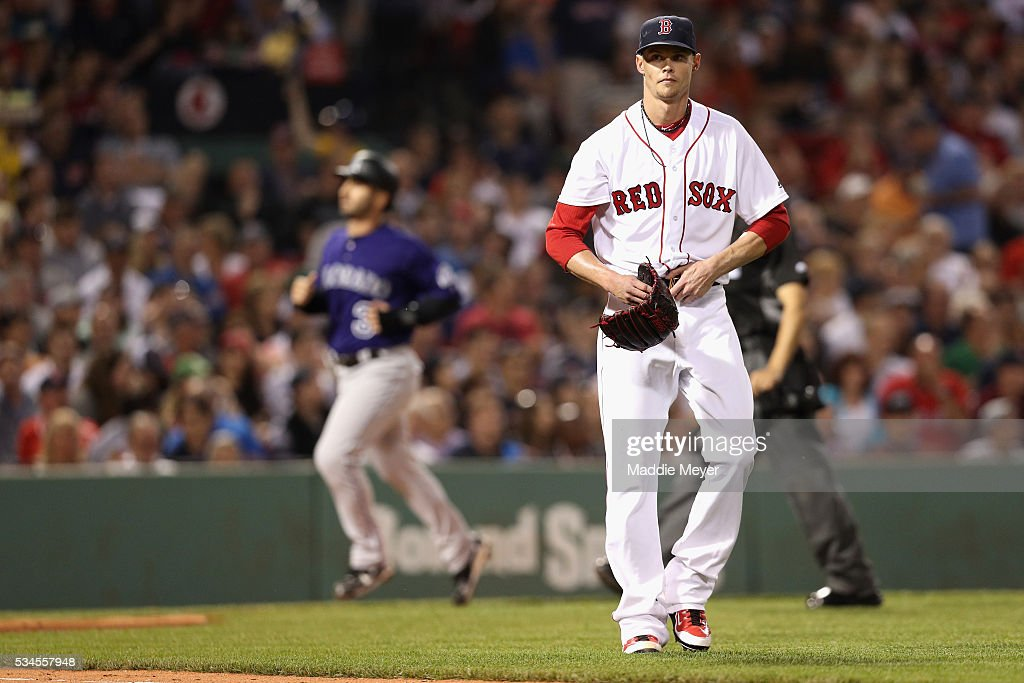 Clay Buchholz #11 of the Boston Red Sox reacts after Dustin Garneau #13 of the Colorado Rockies hit a two run homer during the fifth inning at Fenway Park on May 26, 2016 in Boston, Massachusetts.