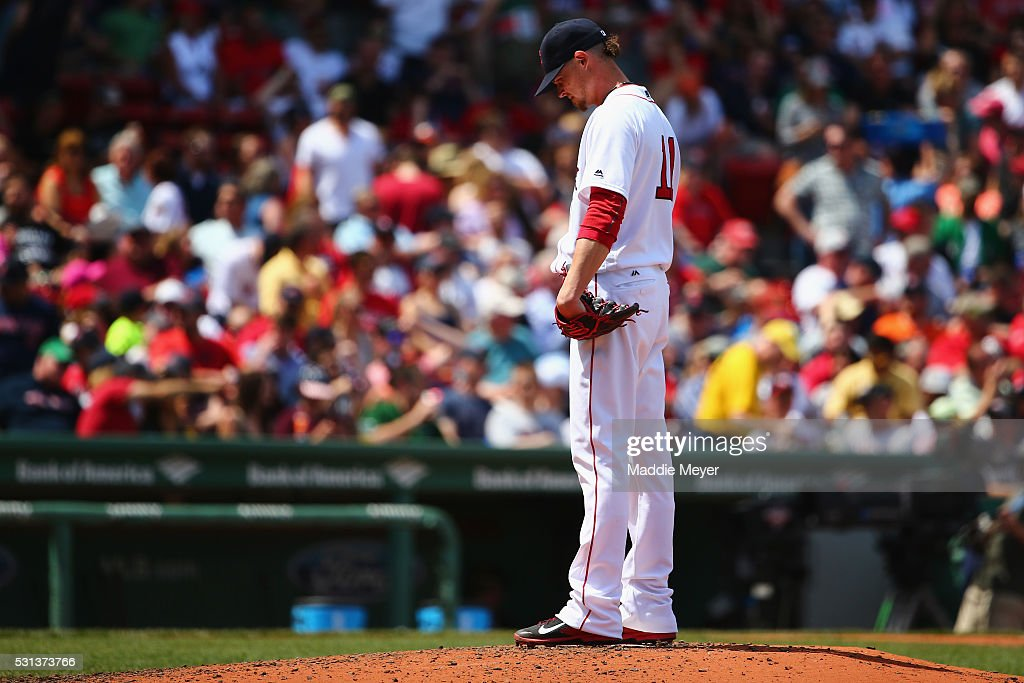 Clay Buchholz #11 of the Boston Red Sox reacts after George Springer #4 of the Houston Astros hit a grand slam during the second inning on May 14, 2016 in Boston, Massachusetts.