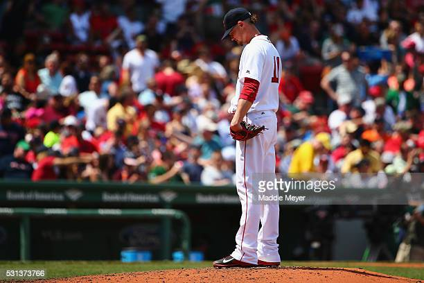 Clay Buchholz of the Boston Red Sox reacts after George Springer of the Houston Astros hit a grand slam during the second inning on May 14 2016 in...