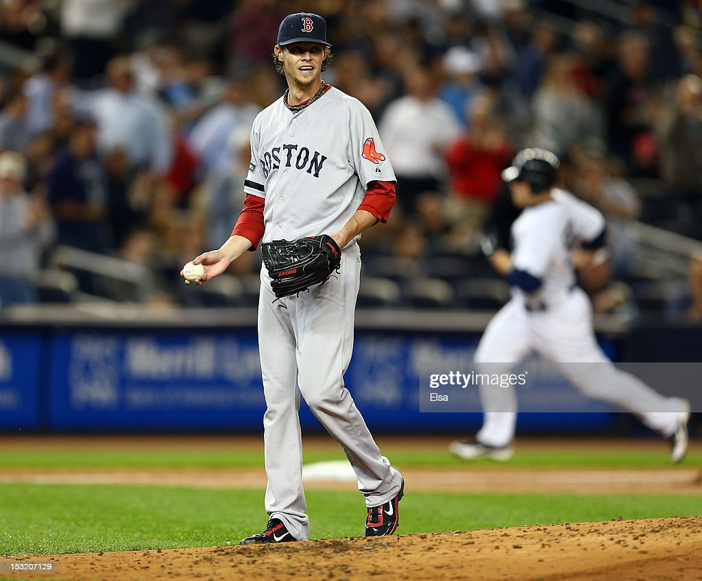 <a gi-track='captionPersonalityLinkClicked' href=/galleries/search?phrase=Clay+Buchholz&family=editorial&specificpeople=4424901 ng-click='$event.stopPropagation()'>Clay Buchholz</a> #11 of the Boston Red Sox reacts after giving up a home run to <a gi-track='captionPersonalityLinkClicked' href=/galleries/search?phrase=Russell+Martin+-+Baseball+Player&family=editorial&specificpeople=13764024 ng-click='$event.stopPropagation()'>Russell Martin</a> #55 of the New York Yankees on October 1, 2012 at Yankee Stadium in the Bronx borough of New York City.