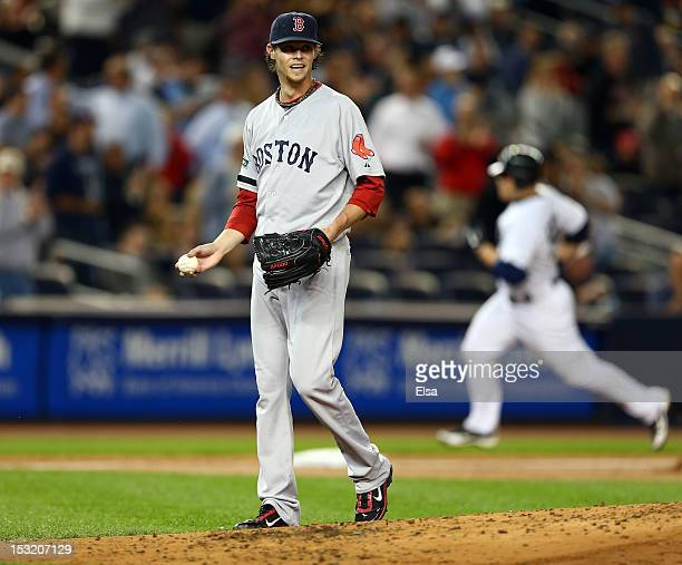 Clay Buchholz of the Boston Red Sox reacts after giving up a home run to Russell Martin of the New York Yankees on October 1 2012 at Yankee Stadium...