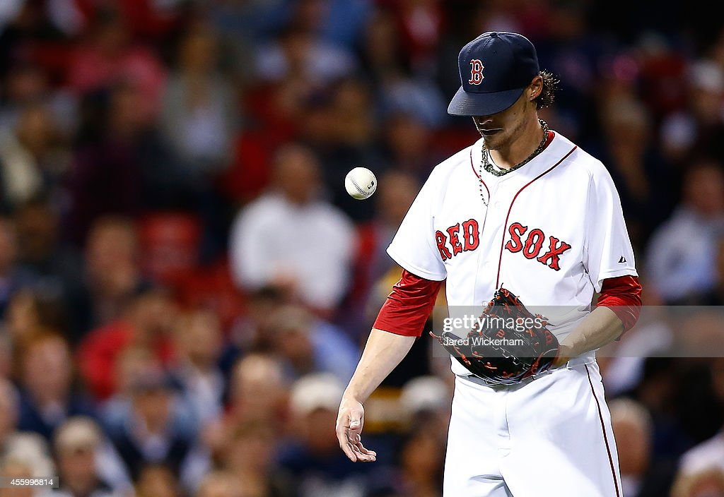 Clay Buchholz #11 of the Boston Red Sox reacts after hitting Evan Longoria #3 of the Tampa Bay Rays in the 8th inning during the game at Fenway Park on September 23, 2014 in Boston, Massachusetts.