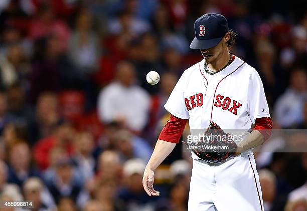 Clay Buchholz of the Boston Red Sox reacts after hitting Evan Longoria of the Tampa Bay Rays in the 8th inning during the game at Fenway Park on...