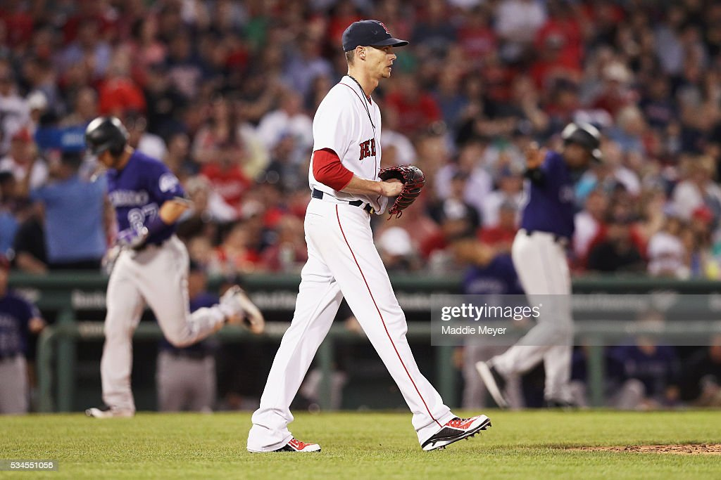 <a gi-track='captionPersonalityLinkClicked' href=/galleries/search?phrase=Clay+Buchholz&family=editorial&specificpeople=4424901 ng-click='$event.stopPropagation()'>Clay Buchholz</a> #11 of the Boston Red Sox reacts after Trevor Story #27 of the Colorado Rockies hit a two run homer during the fifth inning at Fenway Park on May 26, 2016 in Boston, Massachusetts.