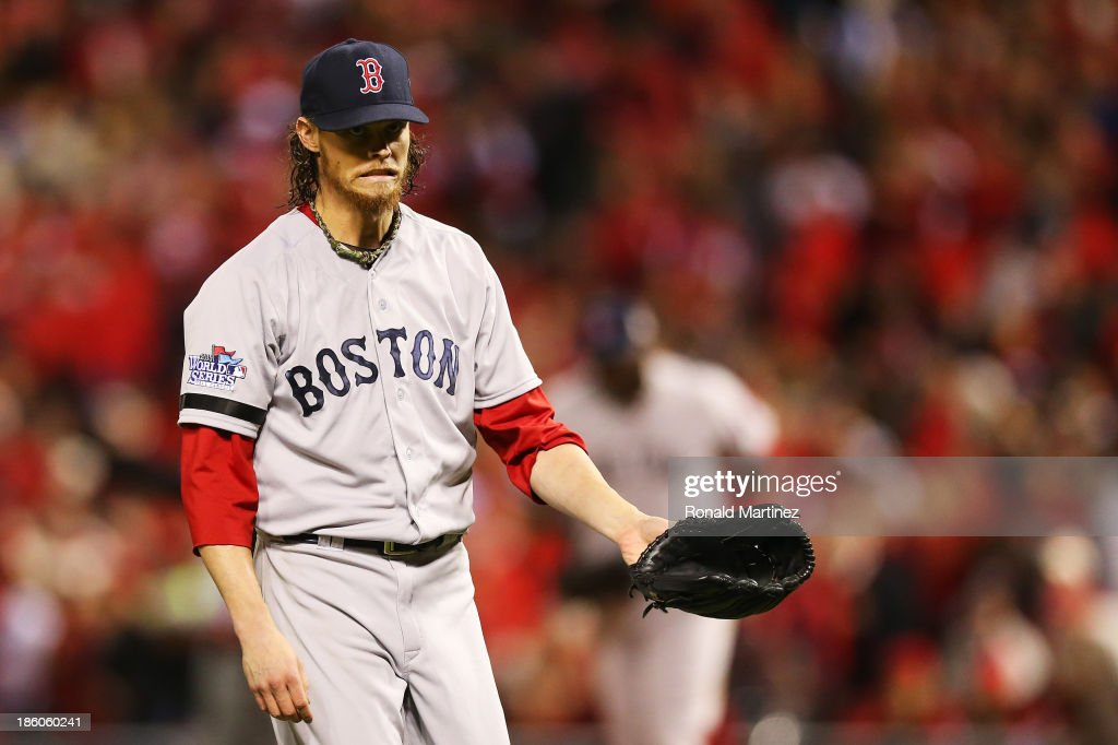 Clay Buchholz #11 of the Boston Red Sox reacts against the St. Louis Cardinals during Game Four of the 2013 World Series at Busch Stadium on October 27, 2013 in St Louis, Missouri.