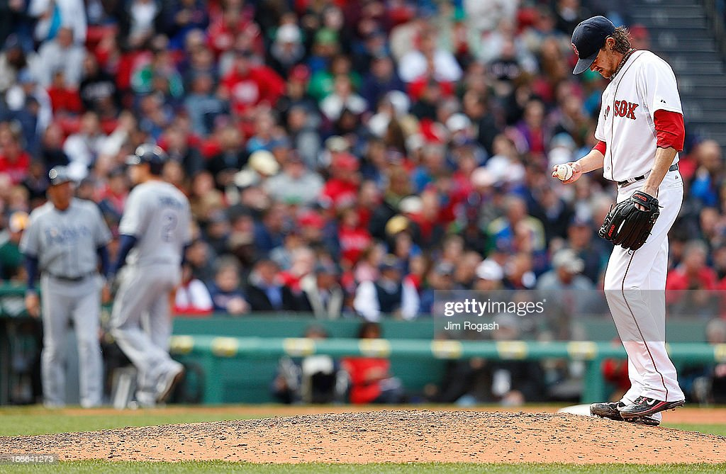 <a gi-track='captionPersonalityLinkClicked' href=/galleries/search?phrase=Clay+Buchholz&family=editorial&specificpeople=4424901 ng-click='$event.stopPropagation()'>Clay Buchholz</a> #11 of the Boston Red Sox reacts as Kelly Johnson #2 of the Tampa Bay Rays leaves the field on a fielder's choice in the eighth at Fenway Park on April 14, 2013 in Boston, Massachusetts. Johnson broke up the no hitter with a broken bat single.