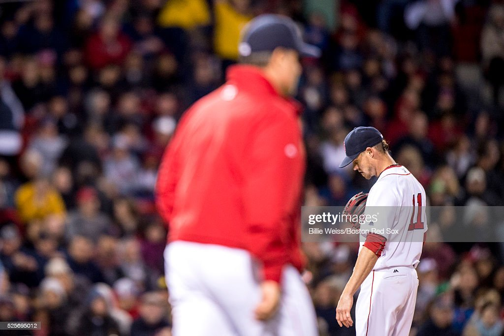 <a gi-track='captionPersonalityLinkClicked' href=/galleries/search?phrase=Clay+Buchholz&family=editorial&specificpeople=4424901 ng-click='$event.stopPropagation()'>Clay Buchholz</a> #11 of the Boston Red Sox reacts as manager <a gi-track='captionPersonalityLinkClicked' href=/galleries/search?phrase=John+Farrell+-+Baseball+Manager&family=editorial&specificpeople=10307520 ng-click='$event.stopPropagation()'>John Farrell</a> walks to the field to challenge a call during the sixth inning of a game against the Atlanta Braves on April 28, 2016 at Fenway Park in Boston, Massachusetts .