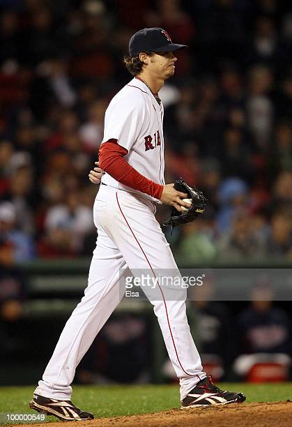 Clay Buchholz of the Boston Red Sox reacts before he is pulled from the game in the top of the ninth inning against the Minnesota Twins on May 19...