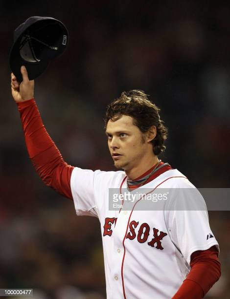 Clay Buchholz of the Boston Red Sox salutes the fans after he is pulled from the game in the top of the ninth inning against the Minnesota Twins on...