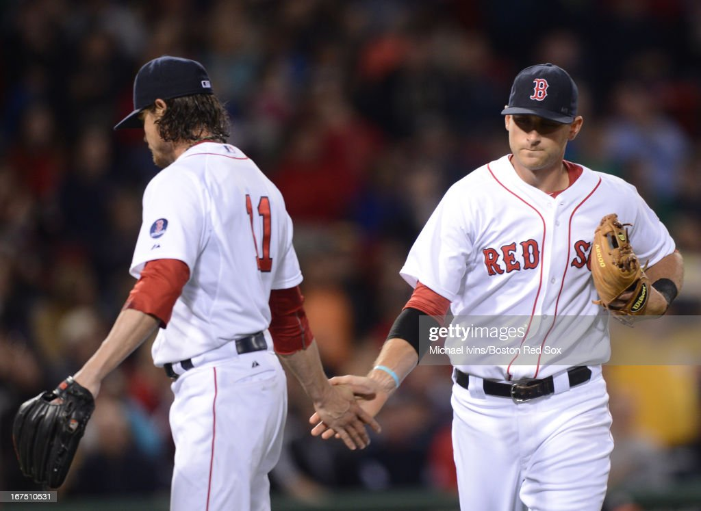 <a gi-track='captionPersonalityLinkClicked' href=/galleries/search?phrase=Clay+Buchholz&family=editorial&specificpeople=4424901 ng-click='$event.stopPropagation()'>Clay Buchholz</a> #11 of the Boston Red Sox slaps hands with <a gi-track='captionPersonalityLinkClicked' href=/galleries/search?phrase=Will+Middlebrooks&family=editorial&specificpeople=7934204 ng-click='$event.stopPropagation()'>Will Middlebrooks</a> #16 after a double play against the Houston Astros in the fourth inning on April 25, 2013 at Fenway Park in Boston, Massachusetts.