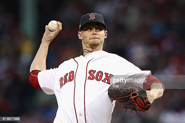 Clay Buchholz of the Boston Red Sox throws a pitch in the first inning against the Cleveland Indians during game three of the American League Divison...