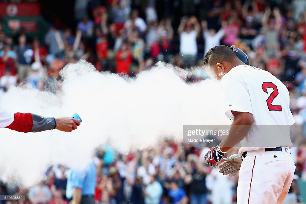 Clay Buchholz #11 of the Boston Red Sox throws powder at Xander Bogaerts #2 after he hit the game winning single during the tenth inning to defeat the Chicago White Sox 8-7 at Fenway Park on June 23, 2016 in Boston, Massachusetts.