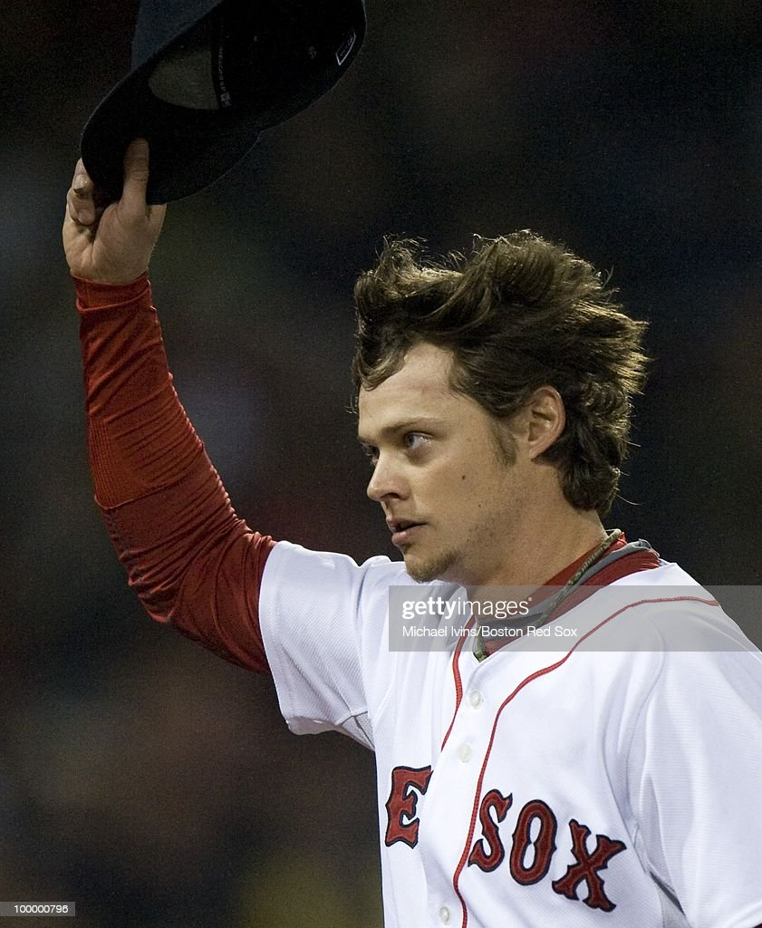 Clay Buchholz #11 of the Boston Red Sox tips his cap after being taken out of the game in the ninth inning against the Minnesota Twins on May 19, 2010 at Fenway Park in Boston, Massachusetts. Buchholz gave up five hits over eight innings and the Red Sox won 3-2.