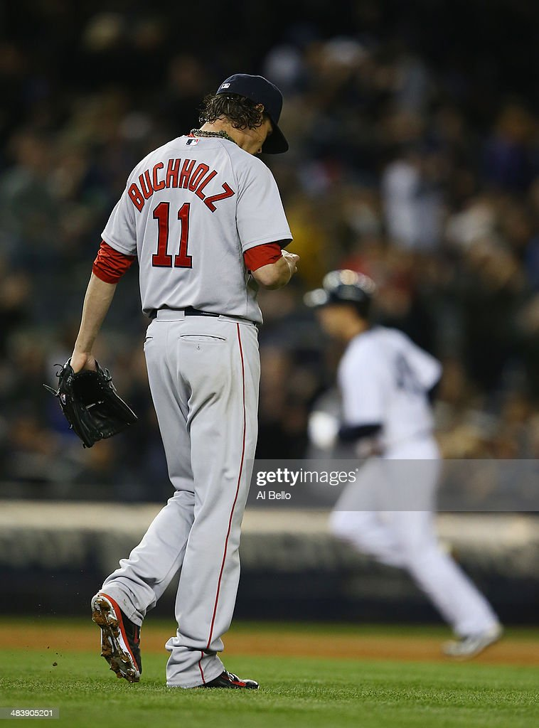 <a gi-track='captionPersonalityLinkClicked' href=/galleries/search?phrase=Clay+Buchholz&family=editorial&specificpeople=4424901 ng-click='$event.stopPropagation()'>Clay Buchholz</a> #11 of the Boston Red Sox walks back to the mound after giving up a home run against Dean Anna #45 of the New York Yankees in the fifth inning during their game at Yankee Stadium on April 10, 2014 in the Bronx borough of New York City.