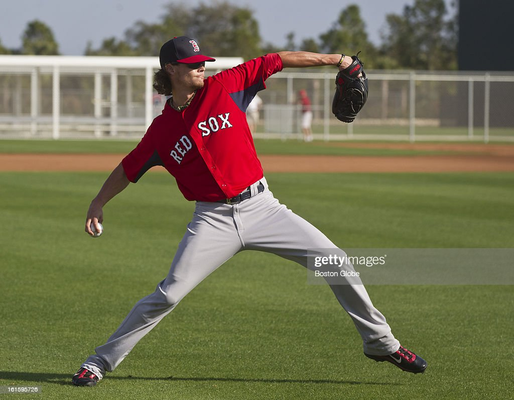 Clay Buchholz throws a long toss during the first official spring training day for the Boston Red Sox pitchers and catchers at JetBlue Park on Tuesday, Feb. 12, 2013.