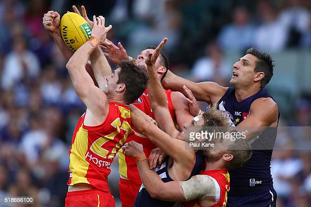 Clay Cameron of the Suns takes a contested pack mark during the round two AFL match between the Fremantle Dockers and the Gold Coast Suns at Domain...
