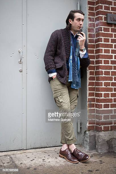 Clay Chambers is seen at Industria Superstudios wearing Haspel wool cardigan and shirt Kiriko scarf Tommy Hilfiger army cargo pants Crosby Square...