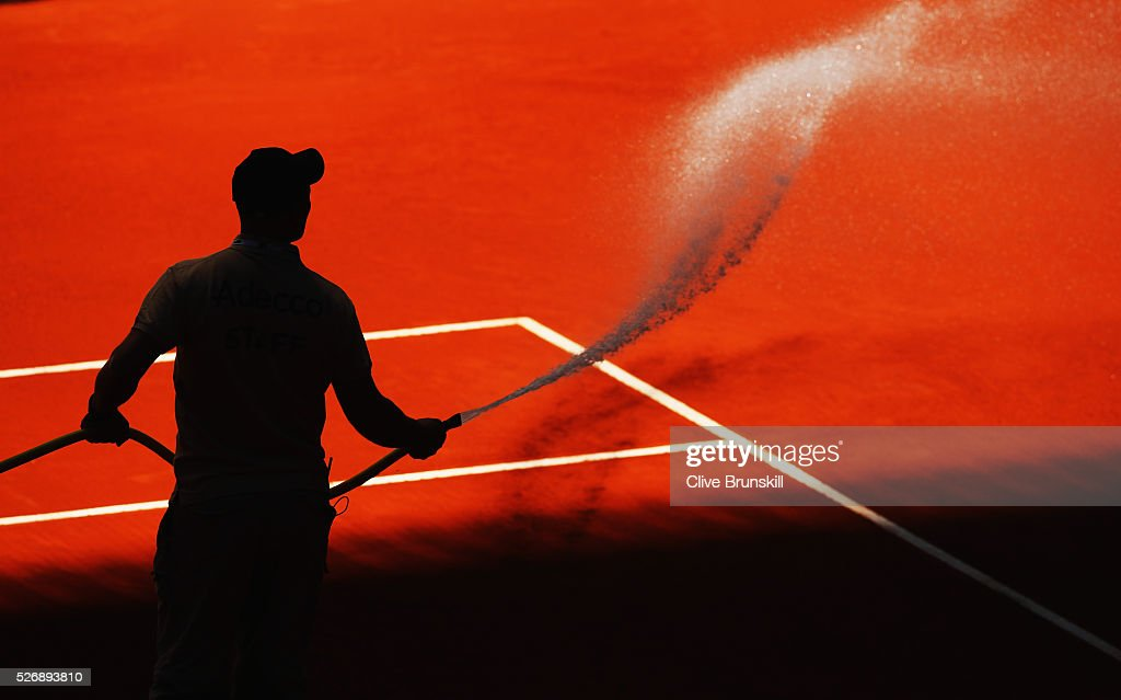 Clay Court preparation by a groundsman between sets during day two of the Mutua Madrid Open tennis tournament at the Caja Magica on May 01, 2016 in Madrid,Spain