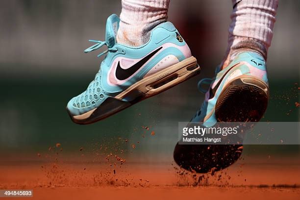 Clay drops from the trainers of Rafael Nadal of Spain during his men's singles match against Leonardo Mayer of Argentina on day seven of the French...