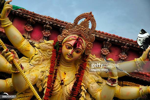 A clay idol of the Hindu Goddess Durga on the day of Bijoya Dashami of Durga Puja festival in Shakhari Bazaar Old Dhaka Durga Puja is one of the...