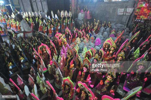 Clay idols of Hindu goddess Lakshmi are displayed for sale at a wholesale market on the eve of the Lakshmi Puja festival in Agartala Hindu devotees...