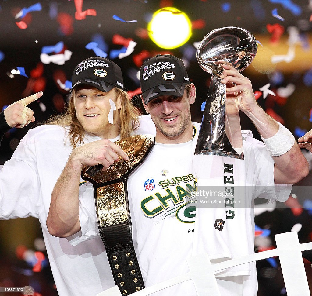 Clay Matthews, left, and Aaron Rodgers celebrate at the trophy presentation at the end of Super Bowl XLV where the Green Bay Packers beat the Pittsburgh Steelers 31-25 at Cowboys Stadium in Arlington, Texas, Sunday, February 6, 2011.