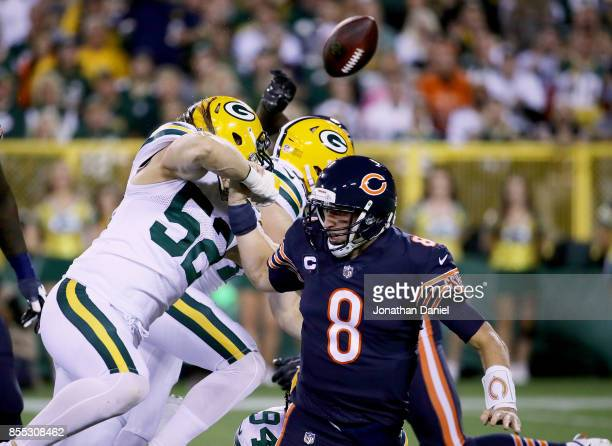 Clay Matthews of the Green Bay Packers sacks Mike Glennon of the Chicago Bears in the first quarter at Lambeau Field on September 28 2017 in Green...