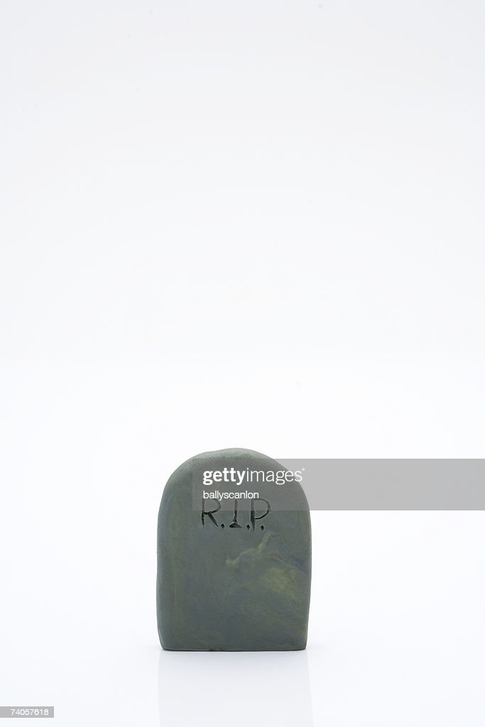 Clay model tombstone, white background