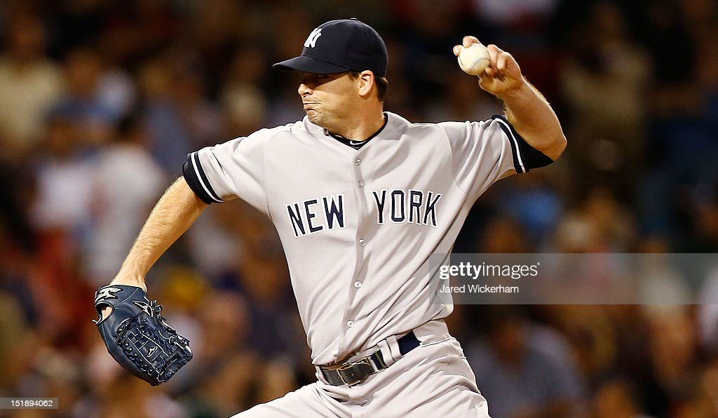 <a gi-track='captionPersonalityLinkClicked' href=/galleries/search?phrase=Clay+Rapada&family=editorial&specificpeople=4175087 ng-click='$event.stopPropagation()'>Clay Rapada</a> #39 of the New York Yankees pitches against the Boston Red Sox during the game on September 12, 2012 at Fenway Park in Boston, Massachusetts.