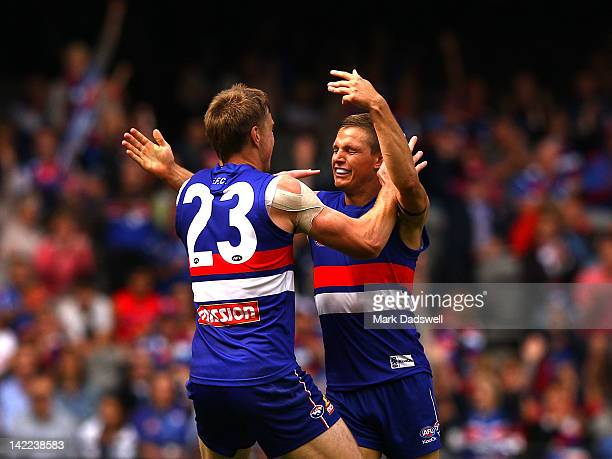Clay Smith of the Bulldogs is congratulated by Jordan Roughead during the round one AFL match between the Western Bulldogs and the West Coast Eagles...