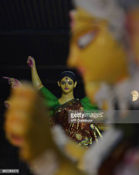 Clay statue of Hindu goddess Durga stand in a workshop in the Indian city of Siliguri on September 23 2017 The fiveday Durga Puja festival...