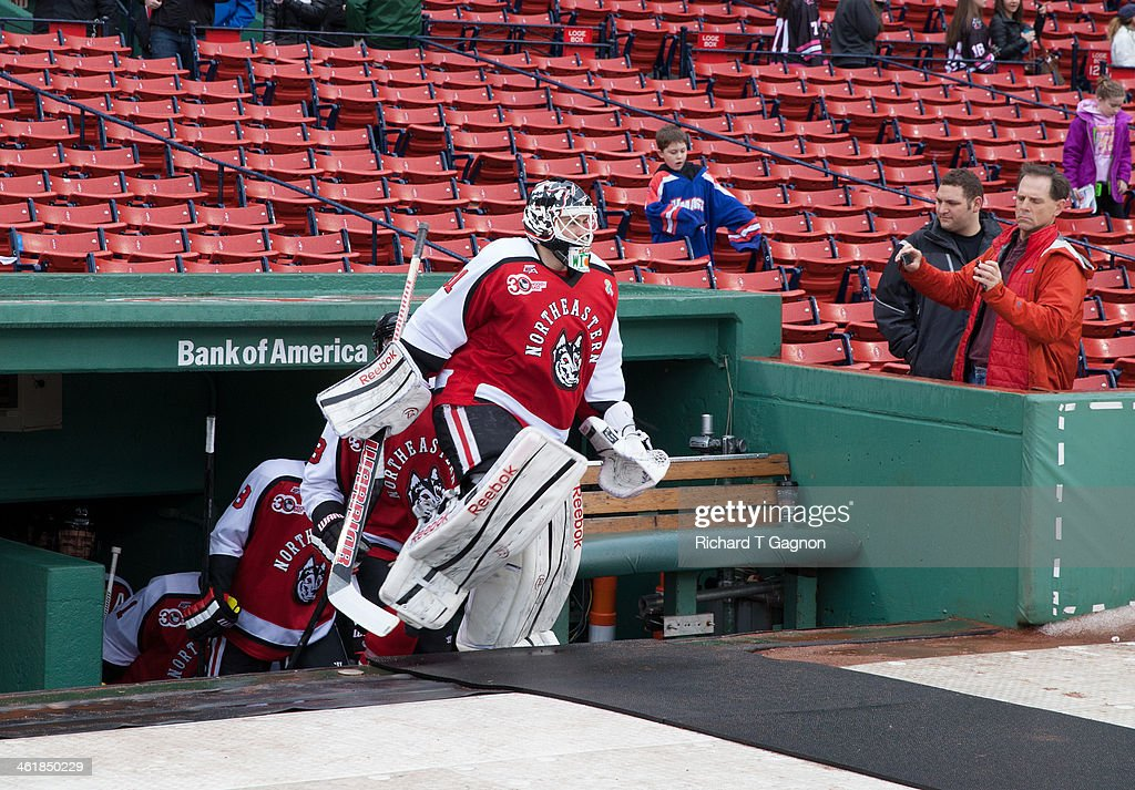 Clay Witt #31 of the Northeastern University Huskies leads his team to the ice before NCAA hockey action against the Massachusetts Lowell River Hawks in the 'Citi Frozen Fenway 2014' at Fenway Park on January 11, 2014 in Boston, Massachusetts.