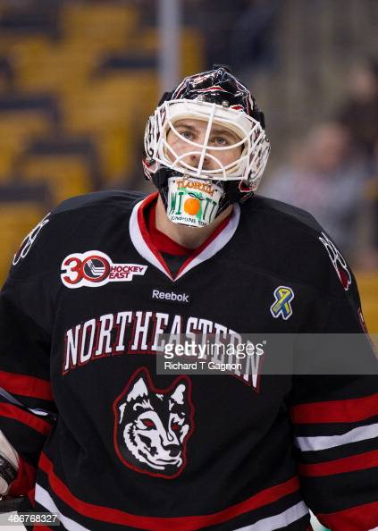 Clay Witt of the Northeastern University Huskies tends goal during NCAA hockey action against the Harvard Crimson in the semifinals of the annual...