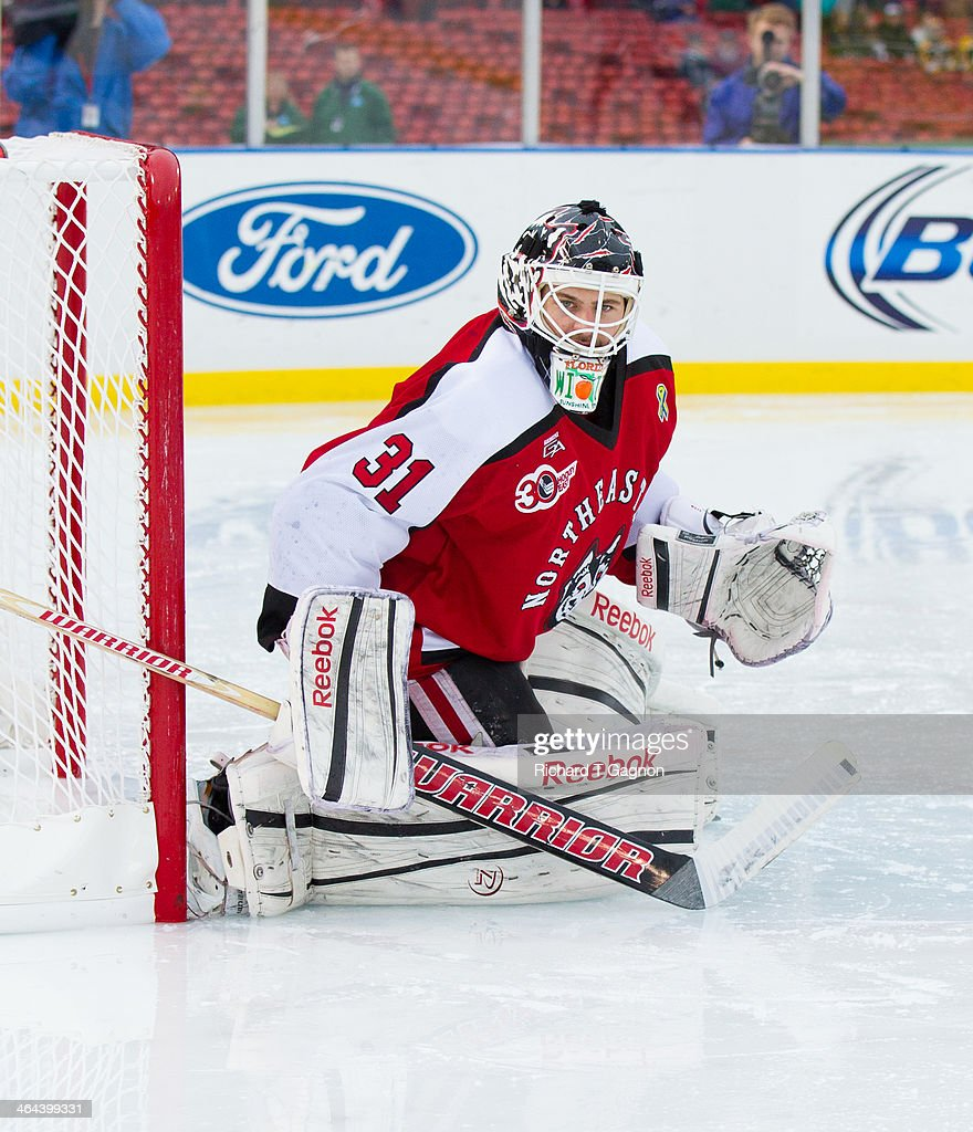 Clay Witt #31 of the Northeastern University Huskies watches the puck during NCAA hockey action against the Massachusetts Lowell River Hawks in the 'Citi Frozen Fenway 2014' at Fenway Park on January 11, 2014 in Boston, Massachusetts.