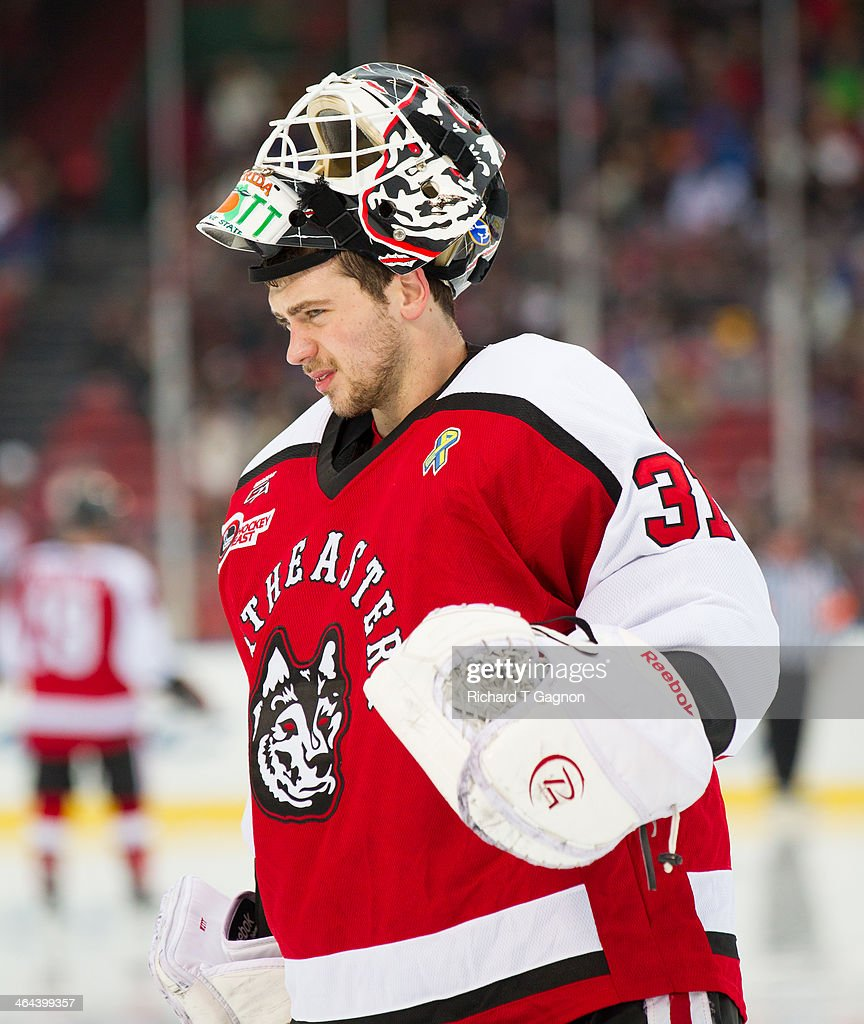 Clay Witt #31 of the Northeastern University Huskies watches the rain during NCAA hockey action against the Massachusetts Lowell River Hawks in the 'Citi Frozen Fenway 2014' at Fenway Park on January 11, 2014 in Boston, Massachusetts.