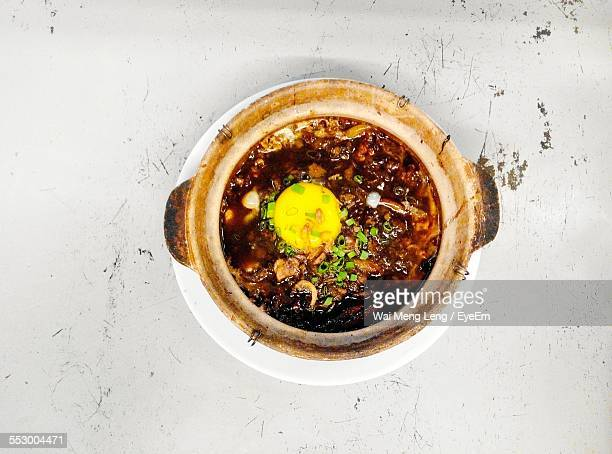 Claypot Noodles With Raw Egg