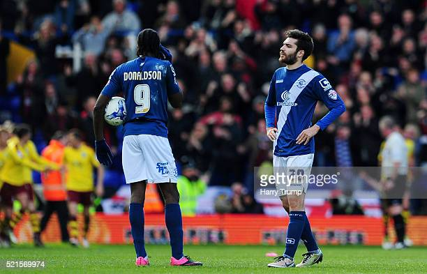 Clayton Donaldson of Birmingham City and Jon Toral of Birmingham City react as Andre Gray of Burnley scores his sides second goal during the Sky Bet...