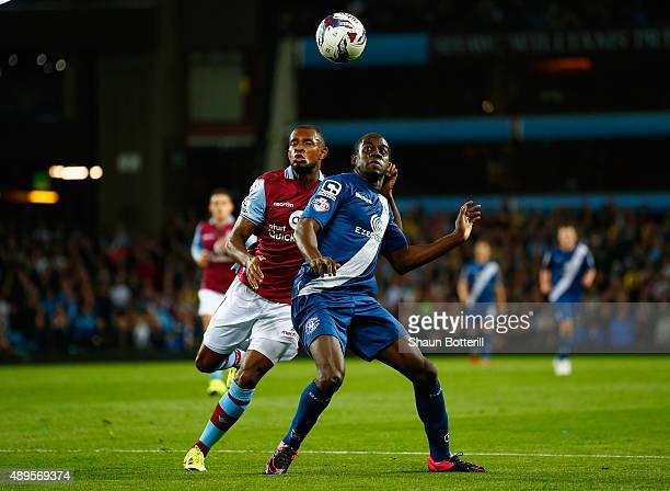 Clayton Donaldson of Birmingham City and Leandro Bacuna of Aston Villa battle for the ball during the Capital One Cup third round match between Aston...