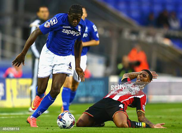 Clayton Donaldson of Birmingham City tangles with Liam Bridcutt of Sunderland during the Capital One Cup second round match between Birmingham City...