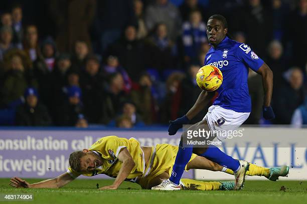 Clayton Donaldson of Birmingham shrugs off the challenge of Jos Hooiveld of Millwall during the Sky Bet Championship match between Birmingham City...