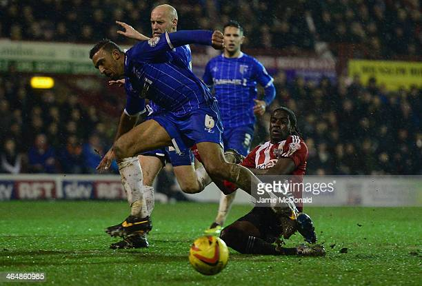 Clayton Donaldson of Brentford battles with Leon Legge of Gillingham during the Sky Bet League One match between Brentford and Gillingham at Griffin...